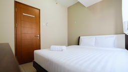 2 Bedrooms at Gading Greenhill Apartment by Travelio