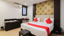 Capital O 15964 NI Ambaari Suites